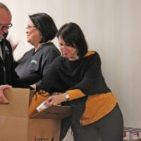 Lumbee River EMC Employees and Directors Fill Boxes for the Community