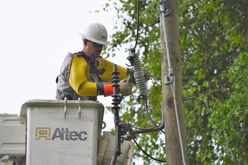 Lineman makes repairs to powerline