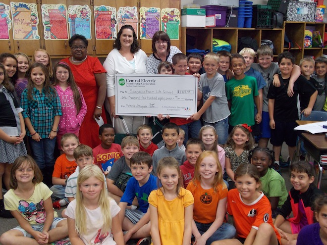 Sandhills Farm Life Elementary accepting their education grant.
