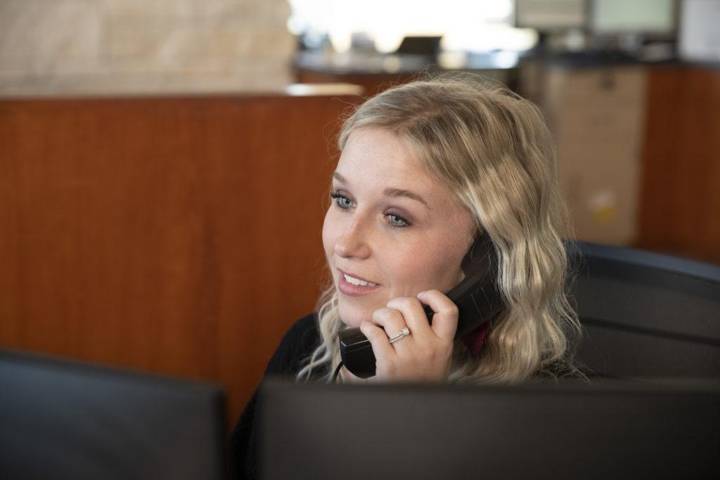 Cooperative Employee on Phone