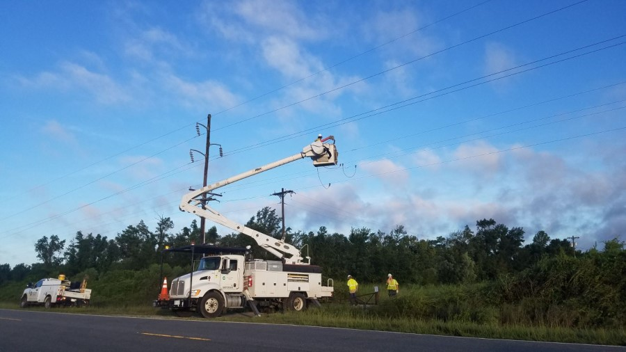 Utility truck and crews restoring power